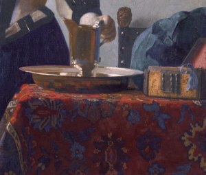 Vermeer_Donna-con-brocca-tavolo